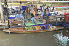 Sales women in a boat on the floating market Stock Images