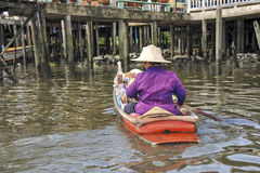 Thai sales women in a boat on the floating market Stock Photos