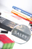 Sales word focused by the magnifying glass Royalty Free Stock Photography