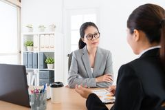 Sales worker explaining new cooperation scheme. Beauty attractive business women listening professional female sales worker explaining new cooperation scheme and Royalty Free Stock Photo