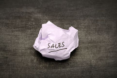 Sales writing on crumpled paper Stock Images