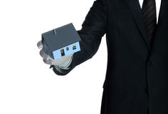 Salesclerk with house in his hand Royalty Free Stock Photos