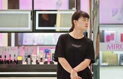 Salesgirl in front of a perfumery outlet in a shopping Mall, Beijing, China Stock Photos