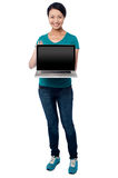 Salesgirl presenting brand new laptop for sale Royalty Free Stock Photo