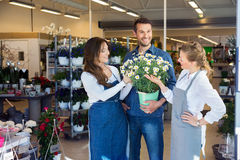 Salesgirls Assisting Male Customer In Buying Stock Photography