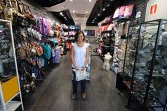 Saleslady em sua loja imagens de stock royalty free