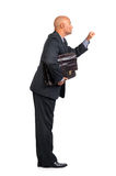 Salesman. Businessman or salesman with briefcase knocking isolated in white royalty free stock image