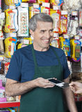 Salesman Accepting Credit Card Payment From Customer Stock Photos