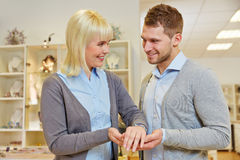 Salesman advising woman in jewelry Stock Image