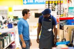 Salesman assisting customer stock image