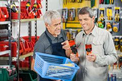 Salesman Assisting Customer In Buying Pliers Stock Photos