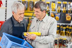 Salesman Assisting Customer In Buying Product Royalty Free Stock Images