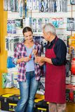 Salesman Assisting Customer In Buying Screwdriver Royalty Free Stock Photography