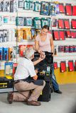 Salesman Assisting Customer In Hardware Store Stock Photography