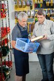 Salesman Assisting Male Customer In Buying Product Royalty Free Stock Images