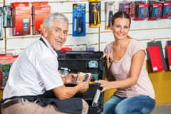 Salesman Assisting Woman In Hardware Store Stock Images