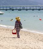 Salesman in the beach in China. Salesman in the beach in China royalty free stock image