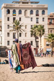 Salesman in the beach. A man selling cloths on beach in Barcelona Royalty Free Stock Images