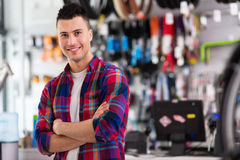 Salesman in bicycle shop Stock Image