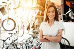 A salesman in a bicycle shop poses near a bicycle. Royalty Free Stock Photos