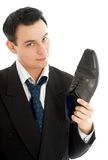 Salesman with black leather boot. Picture of salesman with black leather boot over white royalty free stock image