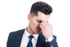Salesman or broker having a headache and stress migraine. Concept isolated on white background Stock Photos