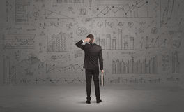 Salesman with business charts on wall Stock Photo