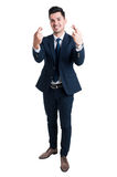 Salesman or businessman making good luck gesture. Salesman or businessman feeling lucky and making double good luck gesture smiling confident Royalty Free Stock Images
