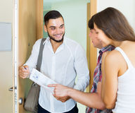 Salesman came home to couple Royalty Free Stock Photos