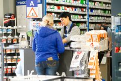 Salesman in the car components shop in Klimovsk stock images
