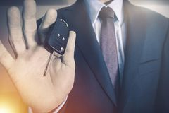 Salesman with Car Keys. Car Salesman with Vehicle Keys. Car Selling Concept Photo. Dealership Salesman with Modern Car Keys royalty free stock photos