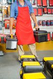 Salesman Carrying Toolboxes In Store Royalty Free Stock Photography