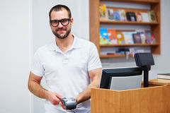 Salesman at the checkout in a bookstore Royalty Free Stock Photo