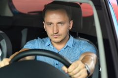 Men is holding wheel in his hands royalty free stock image