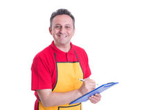Salesman with clipboard taking product inventory. In hypermarket isolated on white background Royalty Free Stock Photography