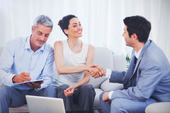 Salesman closing a deal withcouple Stock Images