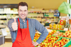 Salesman congratulates with thumbs Stock Photo