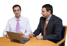 Salesman convincing a tough boss. Two business men discussing a tense issue over a laptop. Isolated on white royalty free stock image