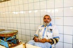 Salesman counting money in Dubai fish market in Deira, United Em Stock Images