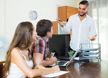 Salesman and couple in the office Stock Photography