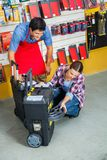 Salesman With Customer Analyzing Tool Case In Stock Photography