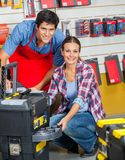 Salesman And Customer With Tool Case In Store Stock Photo