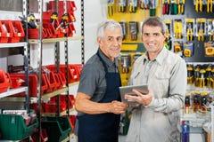 Salesman And Customer Using Tablet Computer Stock Image