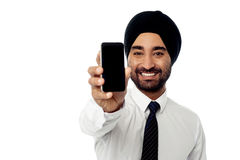 Salesman displaying newly launched mobile phone Royalty Free Stock Photos
