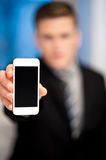 Salesman displaying newly launched mobile. Sales representative displaying stylish cellphone royalty free stock photography