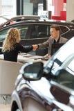 Salesman doing handshake with female customer Royalty Free Stock Images