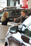 Salesman doing handshake with female customer Stock Photo