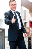 Salesman for domestic kitchen furniture store. Salesman for domestic kitchen in studio or furniture store Royalty Free Stock Photo