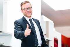 Salesman for domestic kitchen furniture store Stock Photos