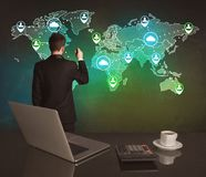 Salesman drawing on world map at office Royalty Free Stock Photos